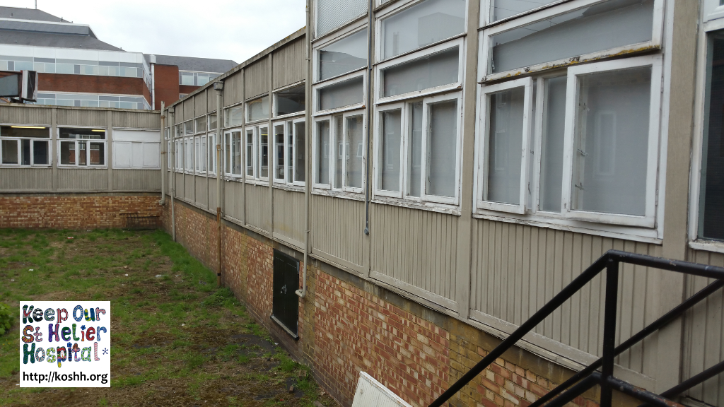 External view of corridor linking buildings in St George's hospital. Please note the single glazed, wooden framed windows.