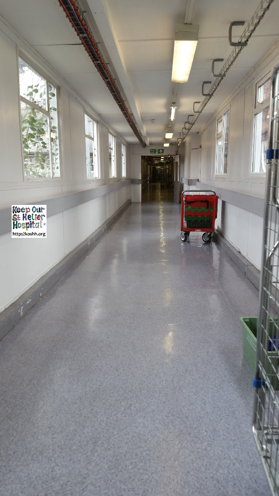 Corridor linking buildings in St George's hospital. Please note the single glazed, wooden framed windows.