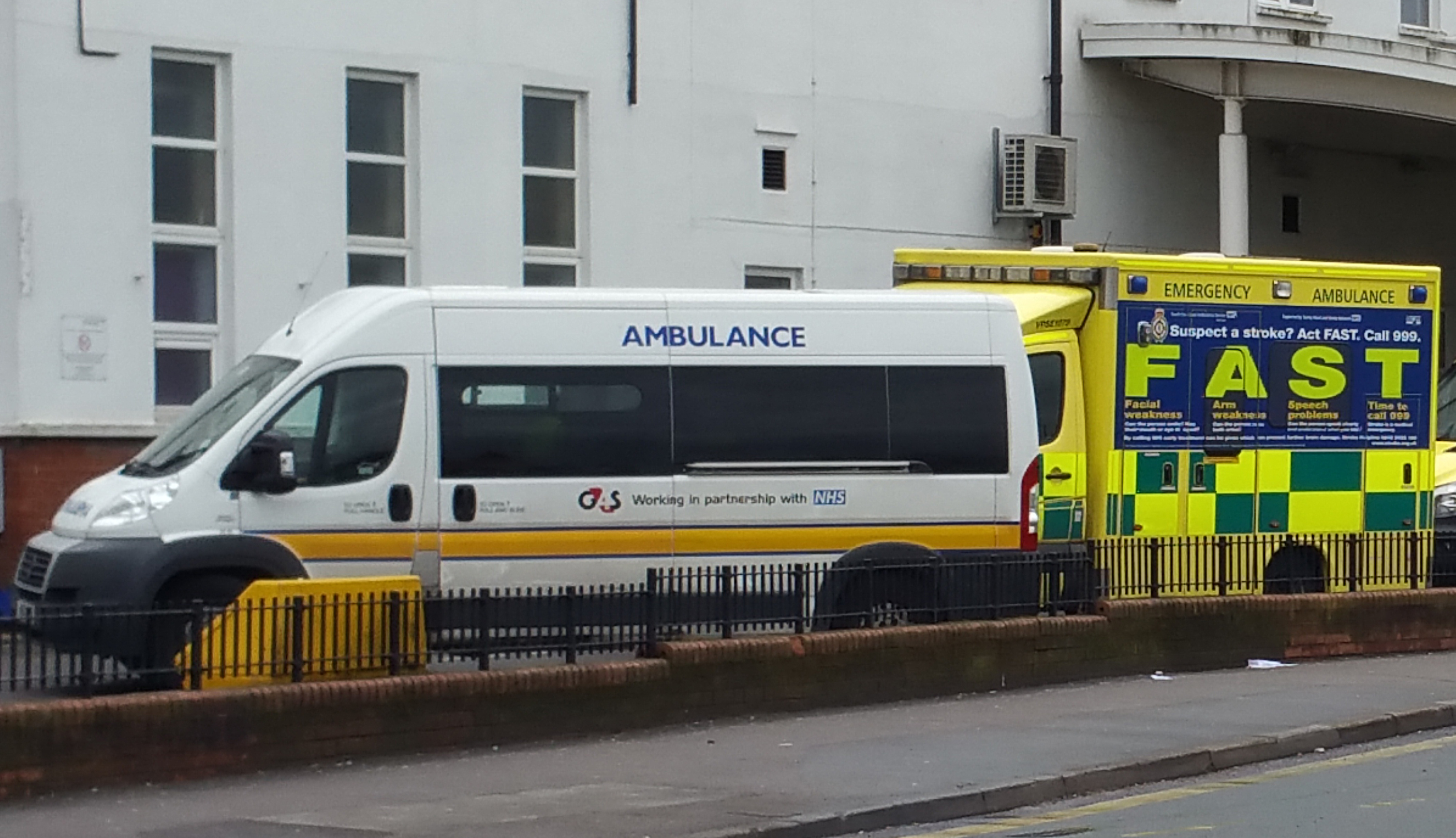 A G4S patient transport ambulance parked outside St Helier hospital, alongside an emergency ambulance.
